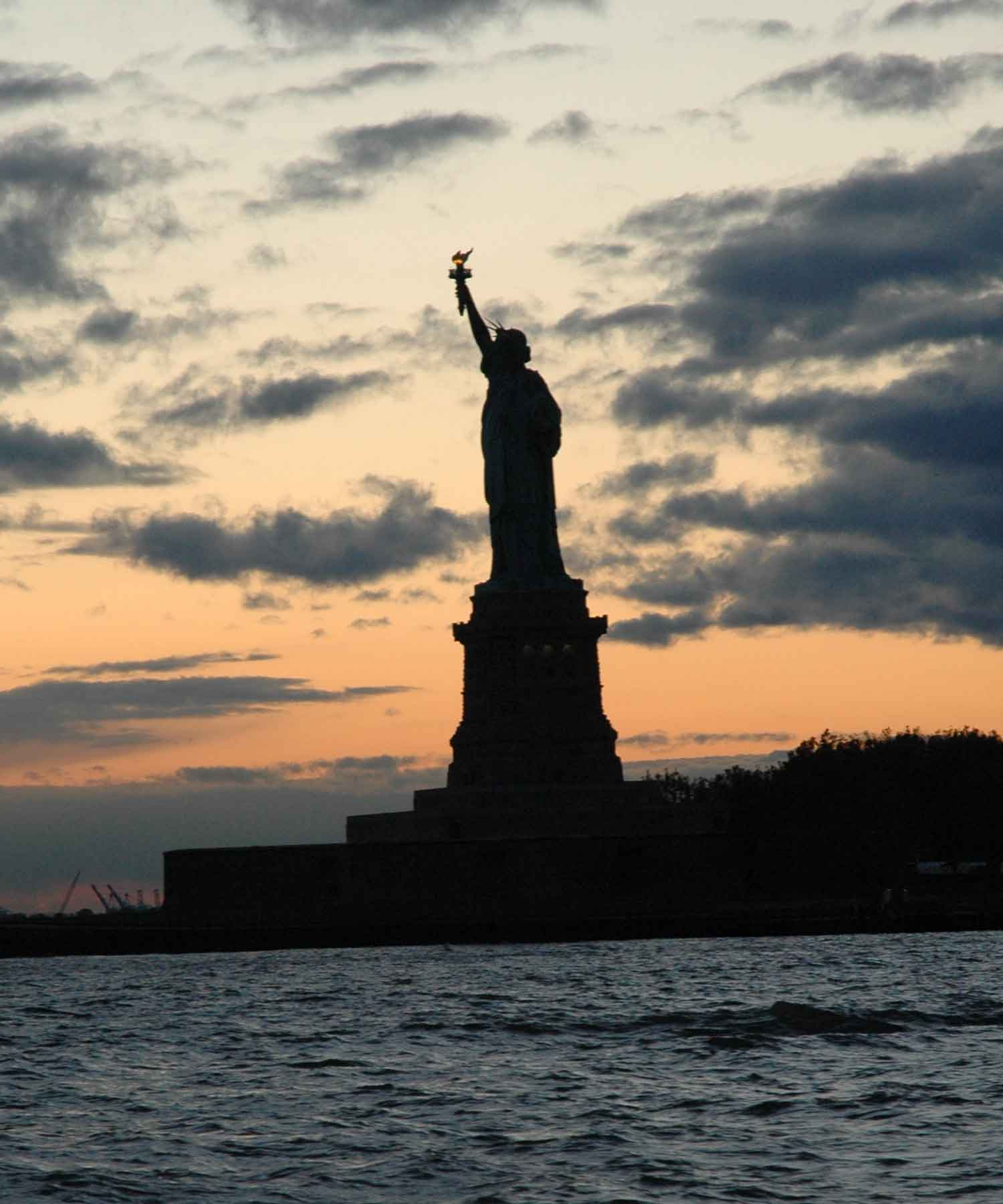Statue of Liberty at sunset.