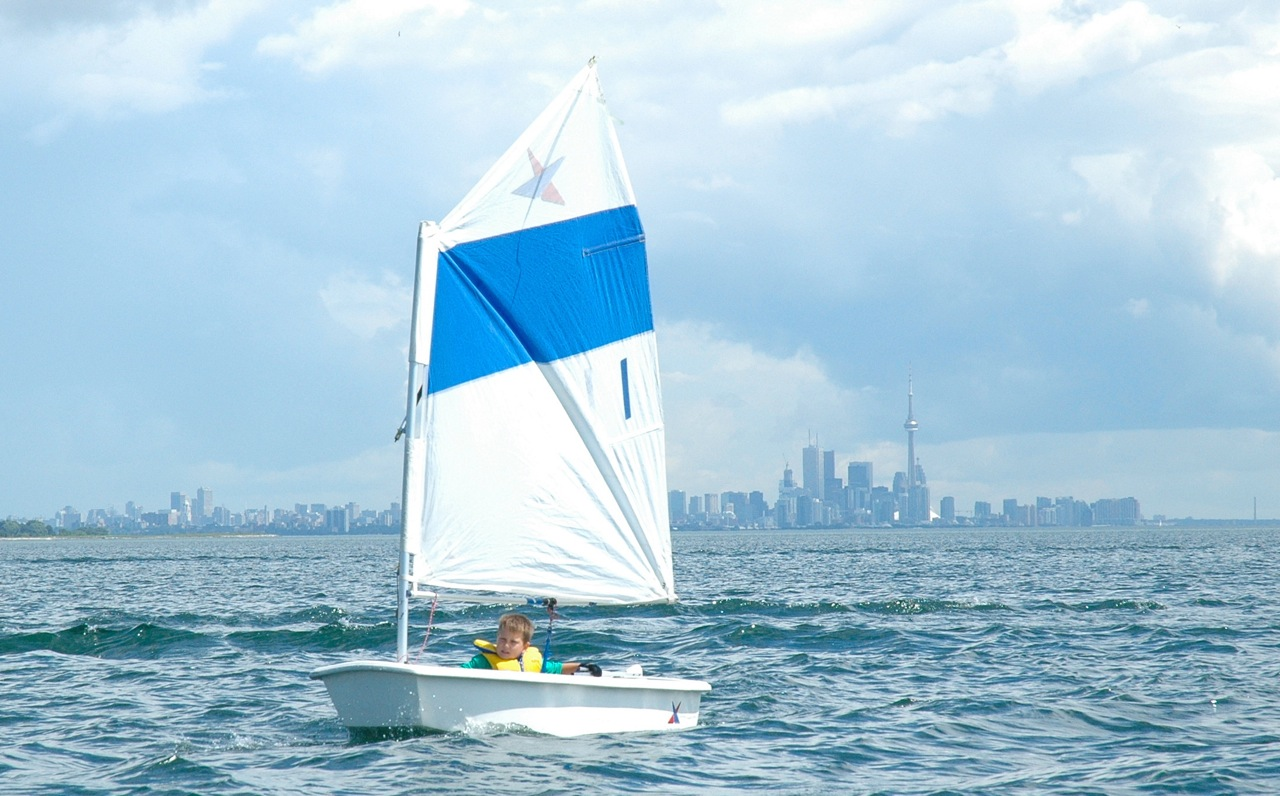 Thomas racing on Lake Ontario, single handing his Opti dinghy.