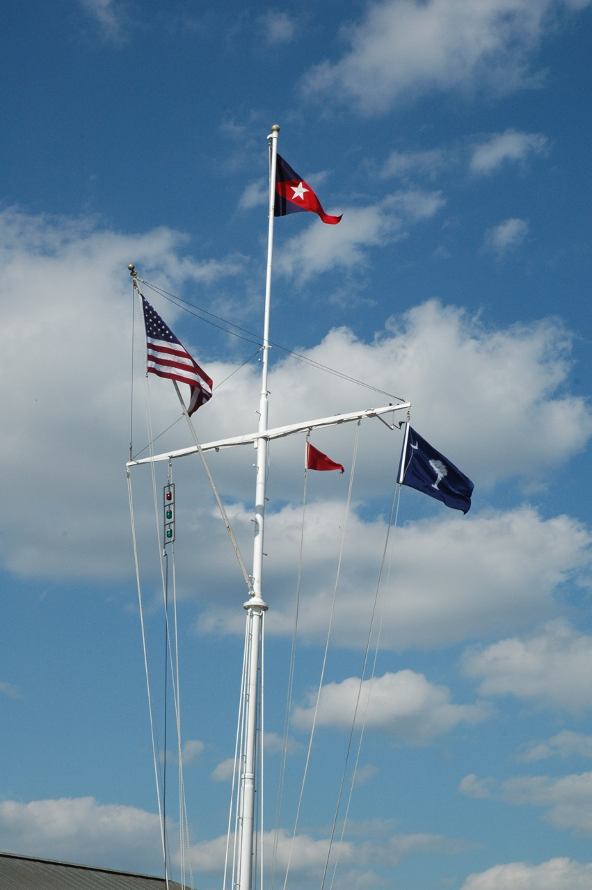 Fort Lauderdale Yacht Club flag pole, with the State of Charleston Flag on the lower right. Club burgee at top.