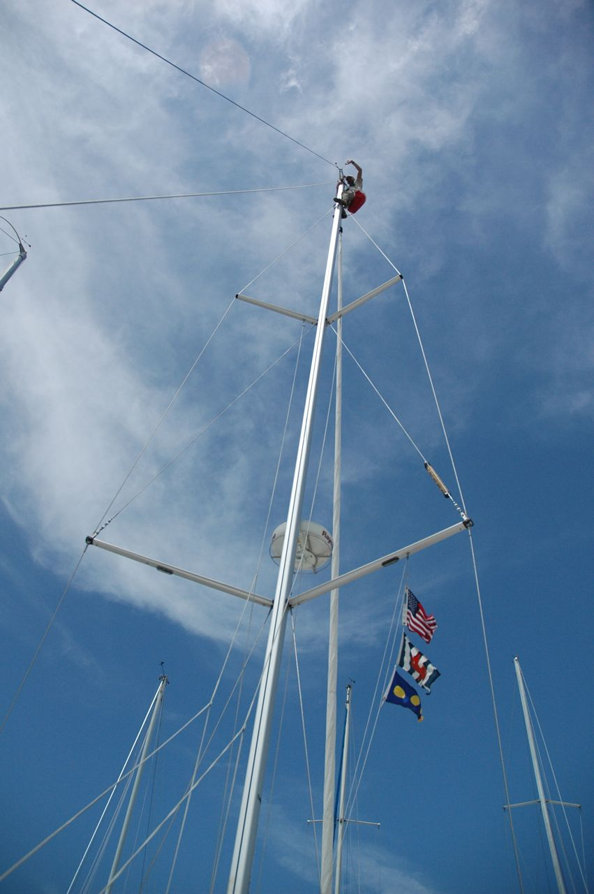 Cez was hoisted to the very top of the mast 61 feet, a full 6 floors up, he inspected the entire rig and halyards.