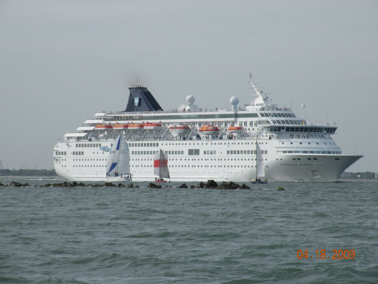 If containerships were not enough, don't forget to dodge the cruise ship as you head for the windward mark. - (c) Copyright 2009