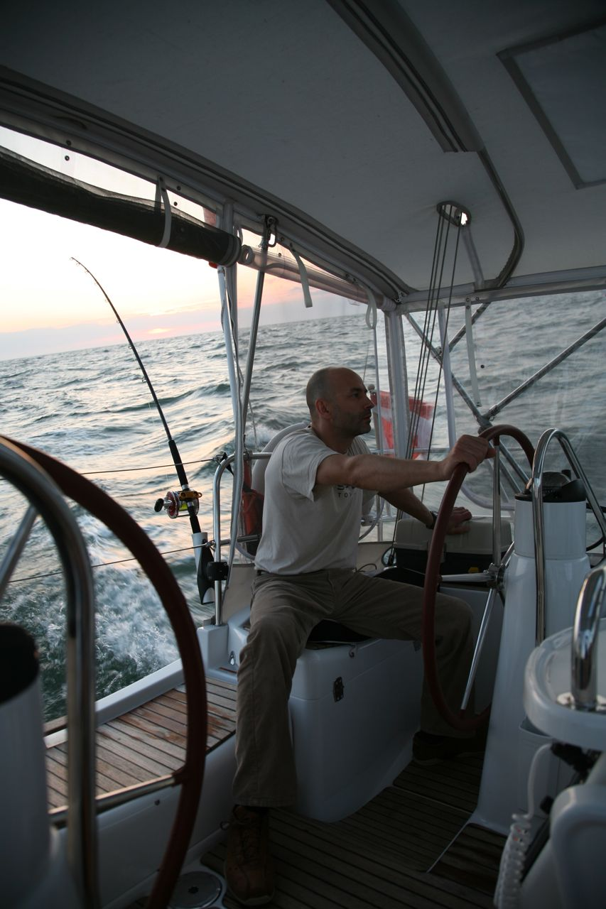 Cezary helming one evening with a beautiful evening breeze.