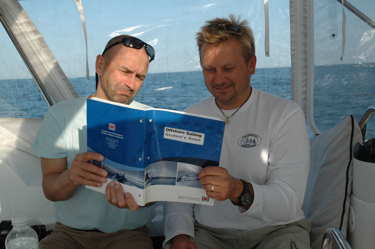 Cez & Ed studying for their Offshore sailing exam while on route in the Atlantic.