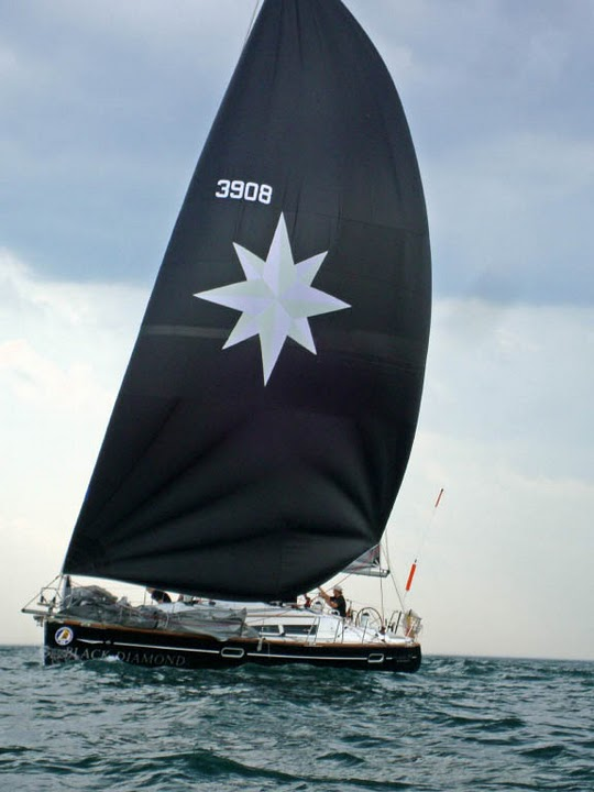 Black Diamond under full main & spinnaker.